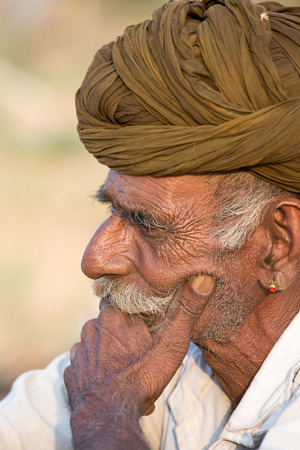 herder: PUSHKAR, INDIA - OCTOBER 27, 2014: Unidentified Indian man attended the annual Pushkar Camel Mela. This fair is the largest camel trading fair in the world.