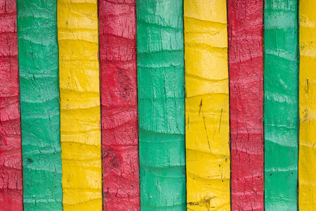 rastafari: Wooden fence painted in yellow, green, red