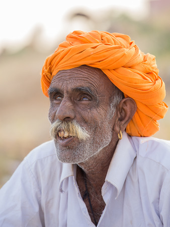 indian fair: PUSHKAR, INDIA - OCTOBER 28, 2014: Unidentified Indian man attended the annual Pushkar Camel Mela. This fair is the largest camel trading fair in the world.