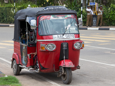 auto rickshaw: MATARA, SRI LANKA - NOVEMBER 5, 2014: Auto rickshaw or tuk-tuk on the street of Matara. Most tuk-tuks in Sri Lanka are a slightly modified Indian Bajaj model, imported from India.