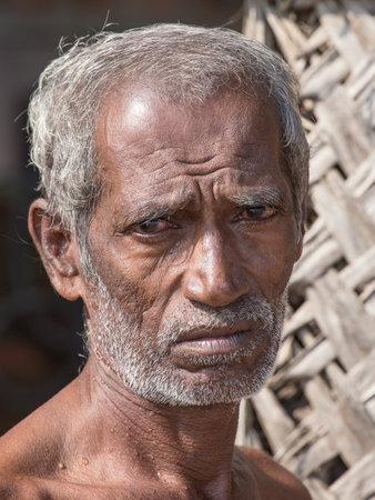 forlorn: MIRISSA, SRI LANKA - NOVEMBER 6, 2014: Unidentified old Sri Lankan beggar waits for alms on a street