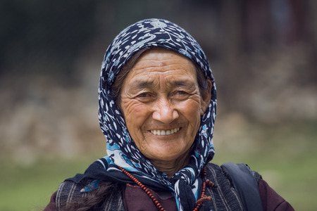descendant: LEH IN LADAKH, INDIA - SEPTEMBER 03 2014: Old unidentified local woman, outdoor in Leh. The majority of the local population are descendant of Tibetan. Editorial