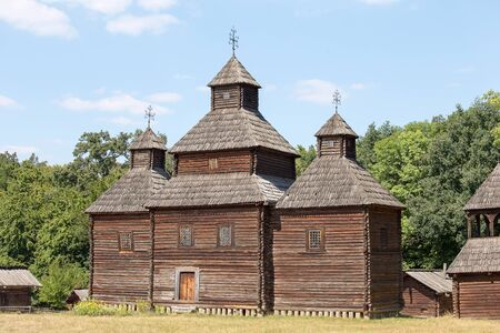 pirogovo: Wooden ukrainian antique orthodox church in summer . Pirogovo museum, Kiev, Ukraine Editorial