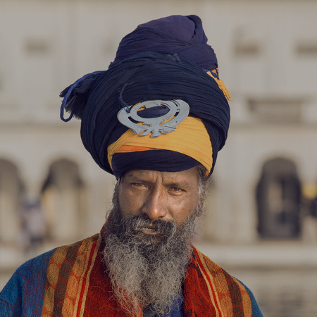 amritsar: AMRITSAR, INDIA - SEPTEMBER 27, 2014: Unidentified Sikh man visiting the Golden Temple in Amritsar, Punjab, India. Sikh pilgrims travel from all over India to pray at this holy site.