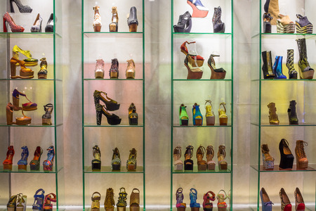 jeffrey: BANGKOK, THAILAND - NOVEMBER 19, 2013 : Lot women shoes brand name - Jeffrey Campbell Shoes on a glass shelf at the Siam Paragon Mall. Siam Paragon is a one of the biggest shopping centres in Asia.
