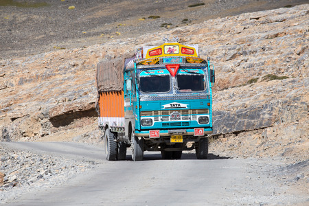 LADAKH, INDIA - SEPTEMBER 09 2014: Truck on the high altitude Manali-Leh road in Lahaul valley, state of Himachal Pradesh, Indian Himalayas, India Editorial