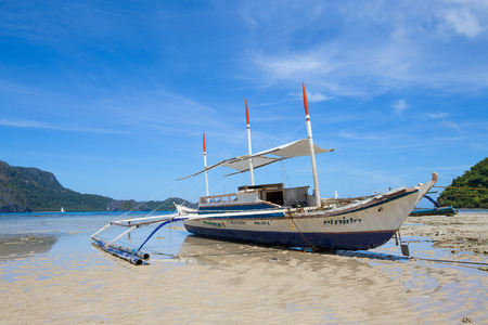tourist destinations: EL NIDO, PHILIPPINES - JANUARY 30, 2014 : Tourist boat on the shallow. El Nido is one of the top tourist destinations in the world.