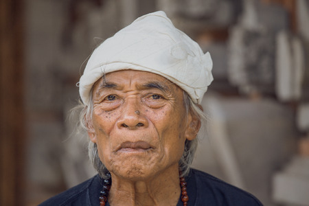 traditional healer: UBUD, INDONESIA - MARCH 10, 2015 : Portrait Ketut Liyer, traditional healer, who starred in the movie  Eat Pray Love  with Julia Roberts in 2010