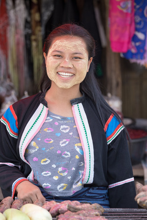thanaka: MAE HONG SON, THAILAND - APRIL 13, 2015 : Portrait Myanmar woman with thanaka on her smile face is happiness. Thanaka is a yellowish-white cosmetic paste made from ground bark.