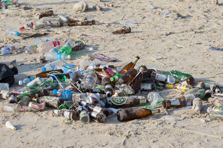 rin: KOH PHANGAN,THAILAND - MAY 3, 2014 : Consequences of coast pollution on the Haad Rin beach after the full moon party