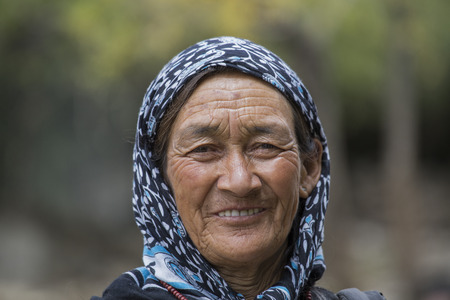 the descendant: LEH IN LADAKH, INDIA - SEPTEMBER 03 2014: Old unidentified local woman, outdoor in Leh. The majority of the local population are descendant of Tibetan. Editorial