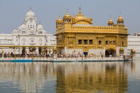 golden temple: AMRITSAR, INDIA - SEPTEMBER 26, 2014: Unidentified Sikhs and indian people visiting the Golden Temple in Amritsar, Punjab, India. Sikh pilgrims travel from all over India to pray at this holy site.