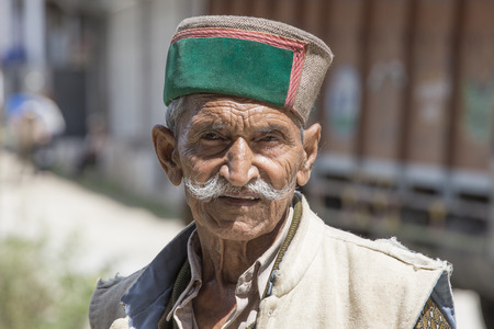 the descendant: MANALI, INDIA - SEPTEMBER 14, 2014: Old unidentified local man, outdoor in Manali . The majority of the local population are descendant of Tibetan.