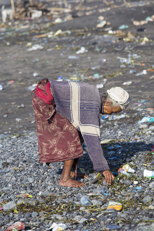 trash the dress: UBUD, BALI, INDONESIA - MARCH 19, 2015 : Unidentified old poor woman to Bali island. Inhabitants of Bali are kind and friendly even in old age