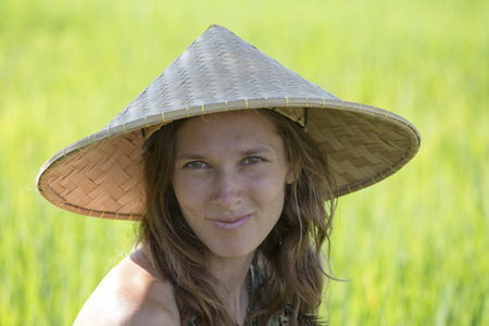 Portrait girl in a straw hat against the backdrop of a rice field in Bali, Indonesia photo