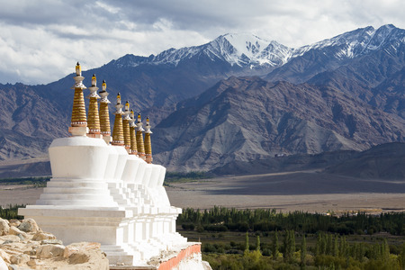 gompa: Buddhist chortens , stupa and Himalayas mountains in the background near Shey Palace in Ladakh, India
