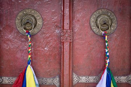 gompa: Door handle of gate door of gompa - Tibetan Buddhist monastery. Ladakh, India Stock Photo