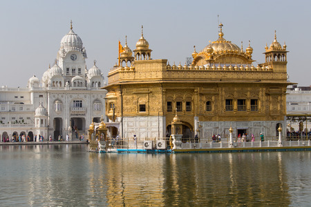 golden temple: AMRITSAR, INDIA - SEPTEMBER 28, 2014: Unidentified Sikhs and indian people visiting the Golden Temple in Amritsar, Punjab, India. Sikh pilgrims travel from all over India to pray at this holy site.