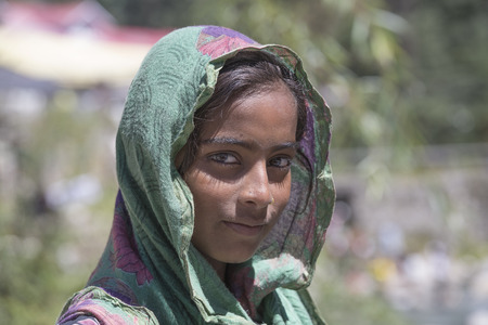 tibetan house: MANALI, INDIA - SEPTEMBER 16, 2014: Unidentified local young girl, outdoor in Manali . The majority of the local population are descendant of Tibetan. Editorial