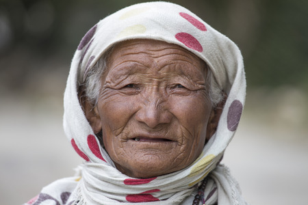 tibetan house: LEH IN LADAKH, INDIA - SEPTEMBER 03 2014: Old unidentified local woman, outdoor in Leh. The majority of the local population are descendant of Tibetan. Editorial