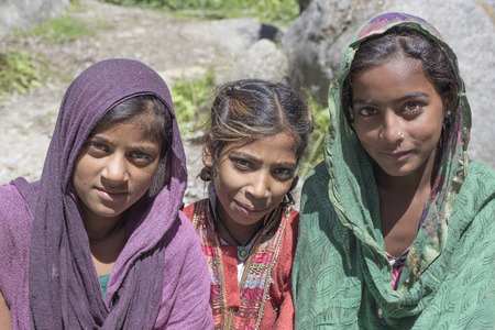 the descendant: MANALI, INDIA - SEPTEMBER 16, 2014: Unidentified local young girls, outdoor in Manali . The majority of the local population are descendant of Tibetan. Editorial
