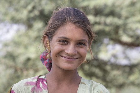attended: PUSHKAR, INDIA - OCTOBER 27, 2014: Unidentified girl at the attended the annual Pushkar Camel Mela. This fair is the largest camel trading fair in the world.