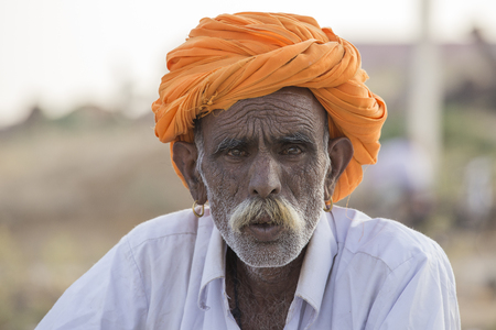 attended: PUSHKAR, INDIA - OCTOBER 28, 2014: Unidentified Indian man attended the annual Pushkar Camel Mela. This fair is the largest camel trading fair in the world.