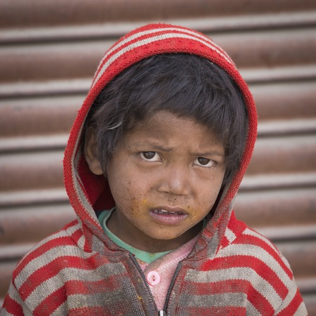 underprivileged: LEH, INDIA - JUNE 29, 2015: Unidentified poor Indian beggar boy on street in Ladakh. Children of the early ages are often brought to the begging profession. Editoriali