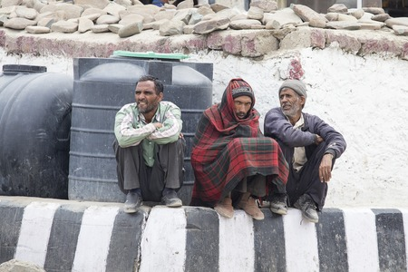 overpopulated: LEH, INDIA - JUNE 29, 2015 : Unidentified tibetan poor men on the streets in Ladakh, North India