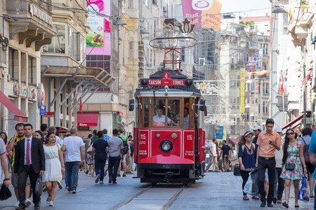 tunel: ISTANBUL, TURKEY - JULY 08, 2014 : The Taksim Tunel Nostalgia Tram trundles along the istiklal street and people at istiklal avenue