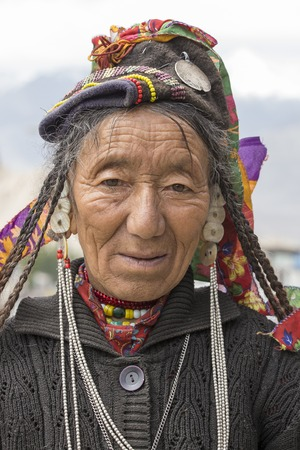 beggar: LEH, INDIA - JUNE 21, 2015: Unknown beggar woman begging on the street in Leh, Ladakh. Poverty is a major issue in India
