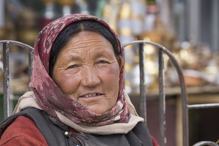 underprivileged: LEH, INDIA - JUNE 21, 2015: Unidentified beggar woman on the street in Leh, Ladakh. Poverty is a major issue in India