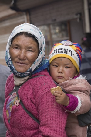 the descendant: LEH, INDIA - JUNE 21, 2015: Unidentified local woman with the child, outdoor in Ladakh. The majority of the local population are descendant of Tibetan.