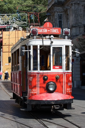 tunel: ISTANBUL, TURKEY - JULY 21, 2015 : The Taksim Tunel Nostalgia Tram trundles along the istiklal street and people at istiklal avenue