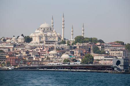 sea port: ISTANBUL, TURKEY - JULY 29, 2015 : Eminonu Harbor, Beyoglu district historic architecture and sea port over the Golden Horn bay in Istanbul, Turkey