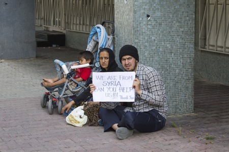 ISTANBUL, TURKEY - AUGUST 03, 2015 : Unknown refugees from Syria are asking for help on the street in Istanbul