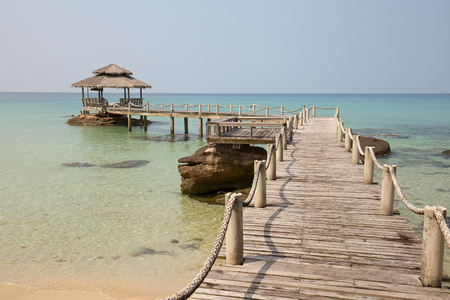 jetty: Wooden pier on the beautiful tropical beach in island Koh Kood , Thailand