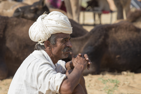 PUSHKAR, INDIA - OCTOBER 27, 2014: Unidentified Indian man attended the annual Pushkar Camel Mela. This fair is the largest camel trading fair in the world.