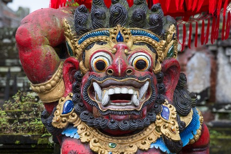Close up of traditional Balinese God statue in Central Bali temple. Indonesia Editorial