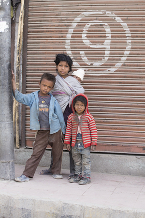 underprivileged: LEH, INDIA - JUNE 29, 2015: Unidentified poor Indian beggar children on street in Ladakh. Children of the early ages are often brought to the begging profession. Editorial
