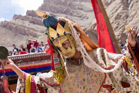 dance time: HEMIS, INDIA - JUNE 26, 2015: Tibetan lamas dressed in mystical mask dance Tsam mystery in time of Yuru Kabgyat festival at Hemis Gompa, Ladakh, North India