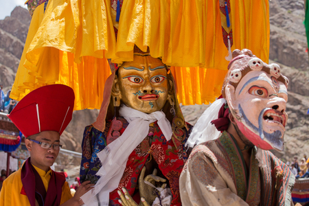 gompa: HEMIS, INDIA - JUNE 26, 2015: Tibetan lamas dressed in mystical mask dance Tsam mystery in time of Yuru Kabgyat festival at Hemis Gompa, Ladakh, North India