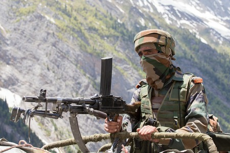 frontier: JAMMU AND KASHMIR, INDIA - JUNE 12, 2015 : Unknown Indian frontier guard. Indian Army checkpoint in Kashmir Himalayas. Kashmir became dangerous again. Editorial