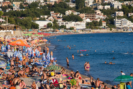 southeast europe: SUTOMORE, MONTENEGRO - SEPTEMBER 07, 2015:  Unidentified people are relaxing on the beach. Montenegro is one of the most attractive destinations for tourists