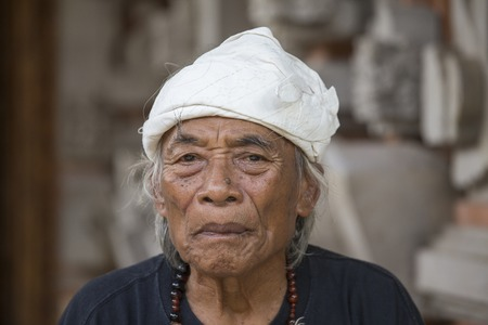 traditional healer: UBUD, INDONESIA - MARCH 10, 2015 : Portrait Ketut Liyer, traditional healer, who starred in the movie - Eat Pray Love , with Julia Roberts in 2010 Editorial