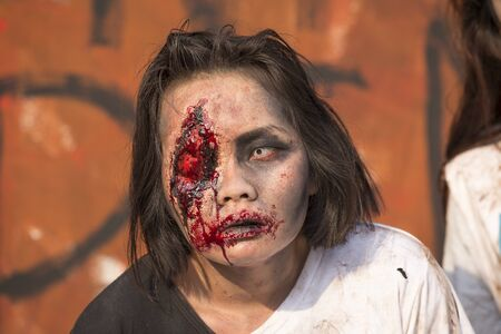 ugly girl: BANGKOK,THAILAND - JANUARY 8, 2015: Unknown Thai girl participates in  FOX Thai The Walking Dead Season 5 Marathon , dressed as zombies Editorial