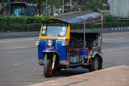 auto rickshaw: BANGKOK,THAILAND - JANUARY 8, 2015: Auto rickshaw or tuk-tuk on the street of Bangkok.Tuk tuks are commonly used in transporting people and goods around the capital Editorial