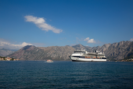 old towns: KOTOR, MONTENEGRO - SEPTEMBER 23, 2015 : Large cruise ship Celebrity Constellation in Boka Kotorsky Bay. Kotor has one of the best preserved medieval old towns in the Adriatic