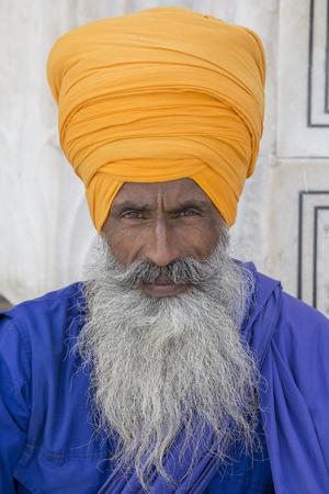 sikh: Portrait indian sikh man in turban with bushy beard. Amritsar, India. Close up