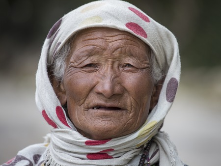 majority: LEH IN LADAKH, INDIA - SEPTEMBER 03, 2014: Old unidentified local woman, outdoor in Leh. The majority of the local population are descendant of Tibetan. Editorial